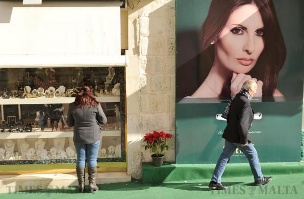A window shopper looks at items on display in Valletta on December 30. Photo: Chris Sant Fournier