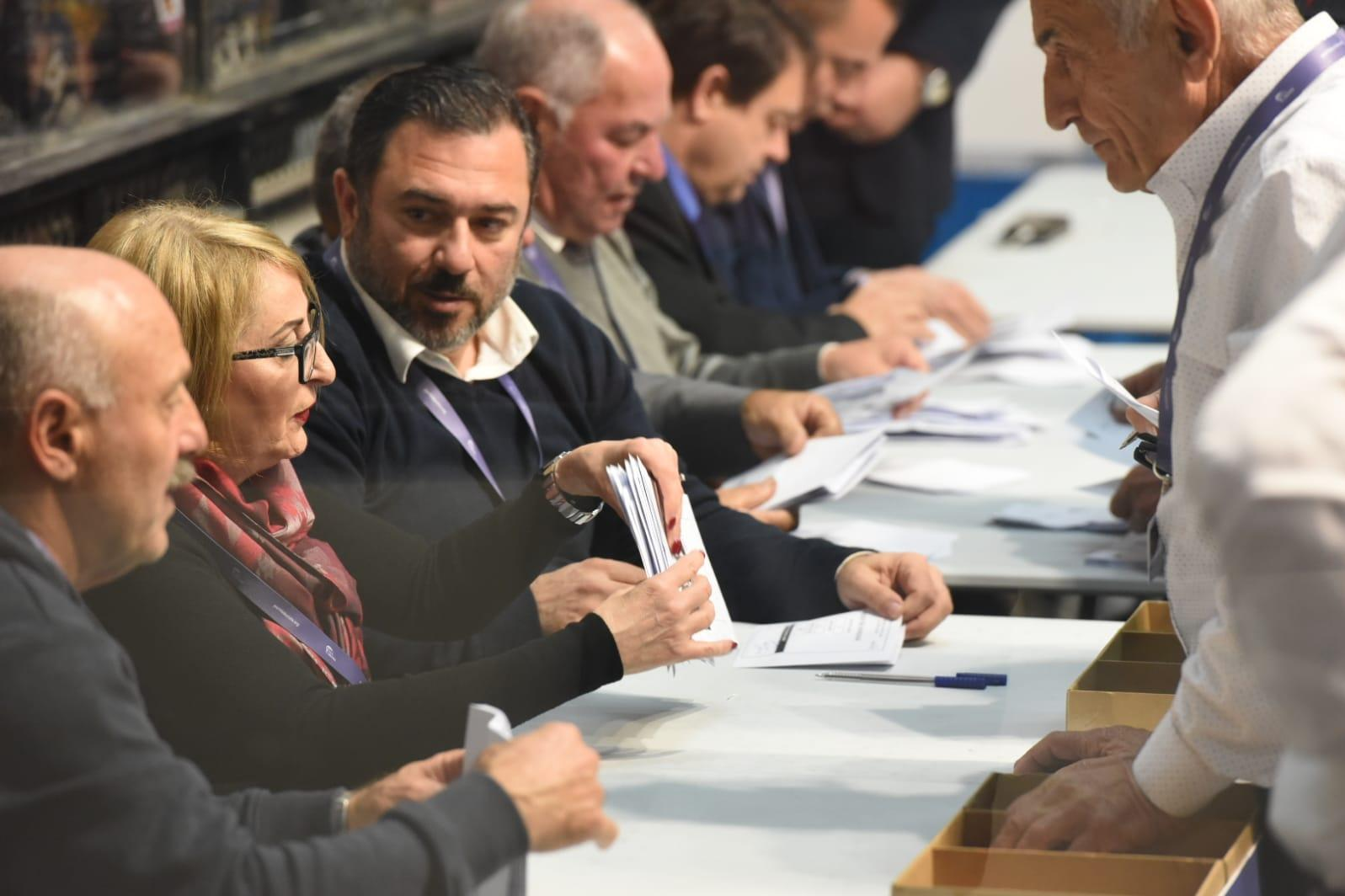 Party officials are kept busy during the vote reconciliation stage. Photo: Chris Sant Fournier