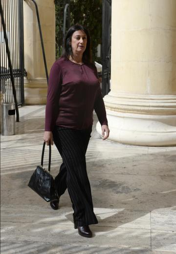 File photo of Daphne Caruana Galizia walking into court.