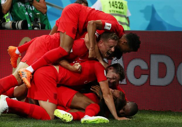 England's Harry Kane celebrates scoring their second goal with team mates.