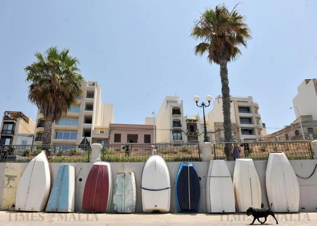 Little boats are stacked against a wall in Bugibba on June 26. Photo: Chris Sant Fournier