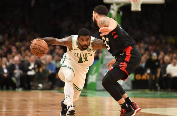 Boston Celtics guard Kyrie Irving (11) controls the ball against Toronto  Raptors forward Pascal 29ba2db935