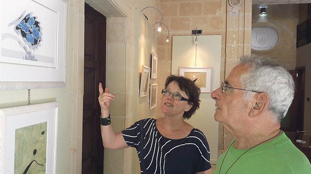 Fiona Mackenzie-Spence shows her work to Augustinian Prior Fr Adeodato Schembri. Photos: Charles Spiteri