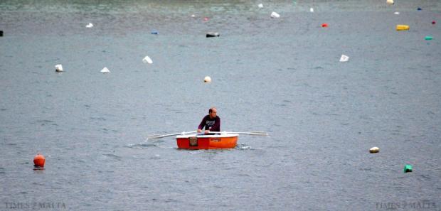 A man rows a small boat in Xemxija on December 8 Photo: Mark Zammit Cordina
