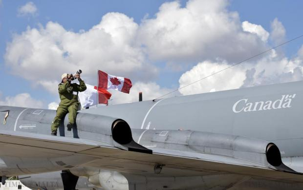 A Canadian Air Force airman takes photos from the wing of a plane at the Malta International Air Show on September 27. Photo: Mark Zammit Cordina