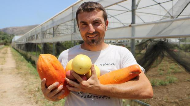 Rosolino Palazzolo with some of the tropical fruits produced on his farm.