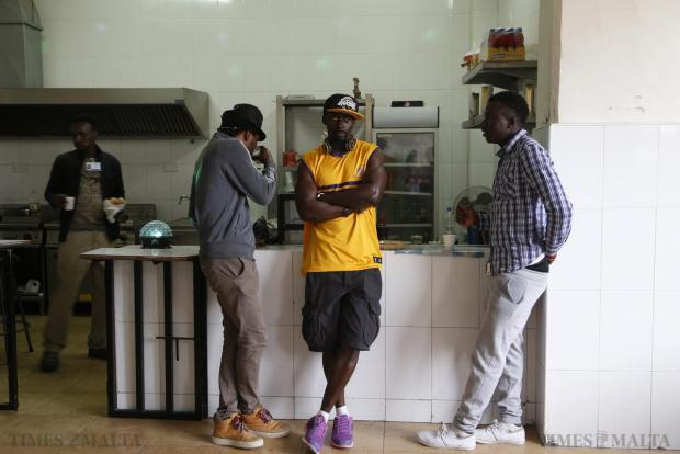 Migrants wait for German President Joachim Gauck to visit a kitchen during a tour of the Marsa Open Centre in Marsa, on April 30. Gauck was in Malta on a two-day state visit, during which he is also meeting with migrants and NGOs working with migrants. Photo: Darrin Zammit Lupi
