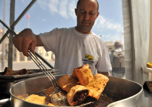 A man cooks 'mqaret' at the Artisanal Fair in St Georges Square in Valletta on May 9. Photo: Chris Sant Fournier