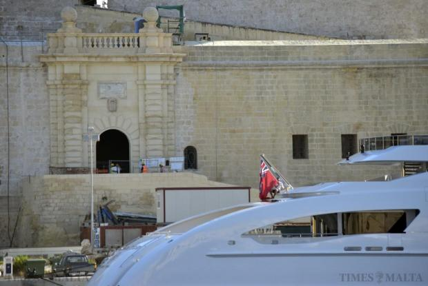 A deck hand arranges the flag of the superyacht Galactica Star in Vittoriosa on August 24. Photo: Mark Zammit Cordina