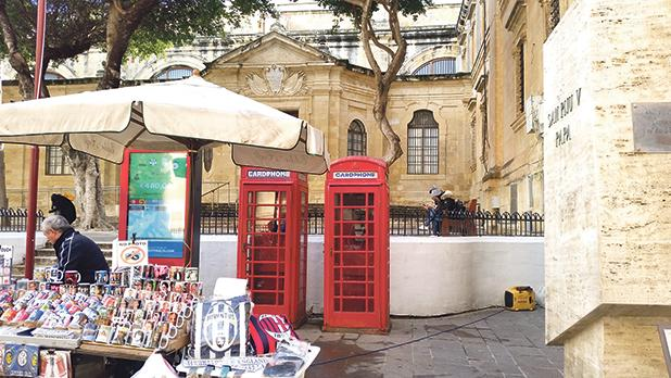 Obsolete red telephone boxes along with other tourist paraphernalia mar St John's entrance in Valletta, generating a kitsch-style appearance to the 16th century architectural gem (photo shot last month).