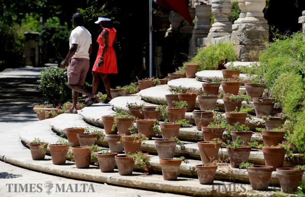 A couple make there way down the stairs at the gardens of San Anton in Attard on June 12. Photo: Matthew Mirabelli