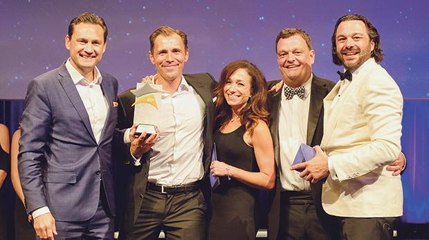 From left: Gustaf Hagman and Robin Ramm Ericson, co-founders of Leo Vegas, accepting the Outstanding Contribution to the Industry award with Rebecca Liggero, Jon Thompson and Michael Caselli.