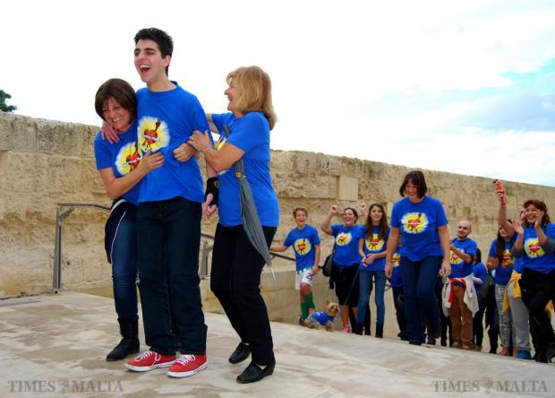 Jacob Cachia is helped to overcome his extreme fear of heights to conquer the 77 steps at the entrance to Valletta on December 7. The achievement marked another milestone in the teenager's long journey of survival after he contracted a brain infection. Photo: Mark Zammit Cordina