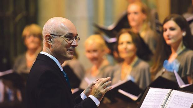 Hugo Agius Muscat conducting the choir.