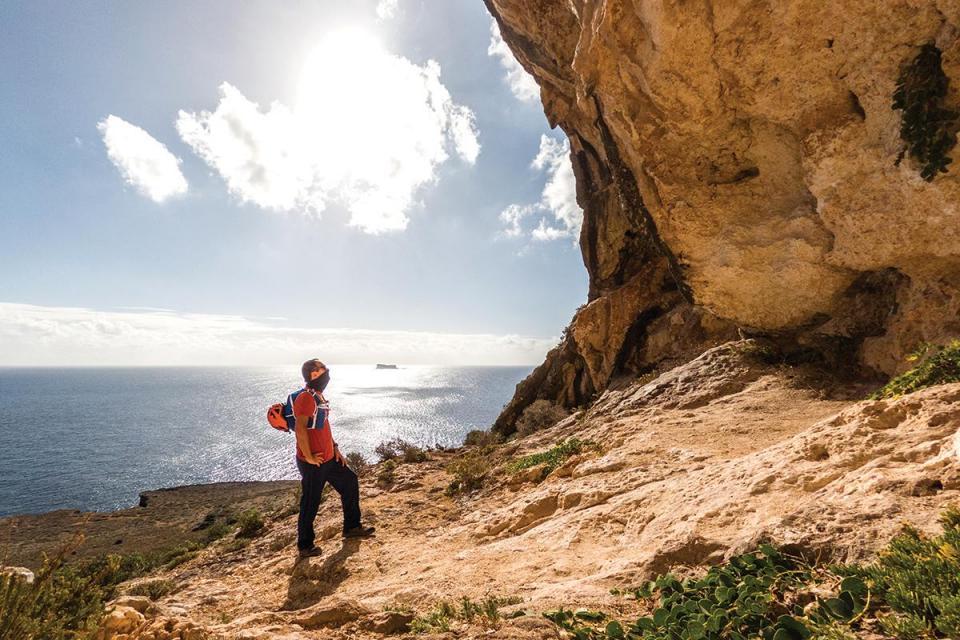 Exploring the caves at Għar Lapsi