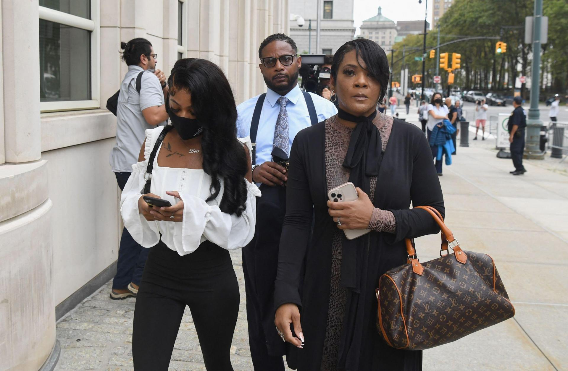 Family members of victim Jocelyn Savage arrive to attend the trial in the racketeering and sex trafficking case of R. Kelly at Brooklyn Federal Court in Brooklyn, New York on August 18, 2021. Photo: Angela Weiss/AFP