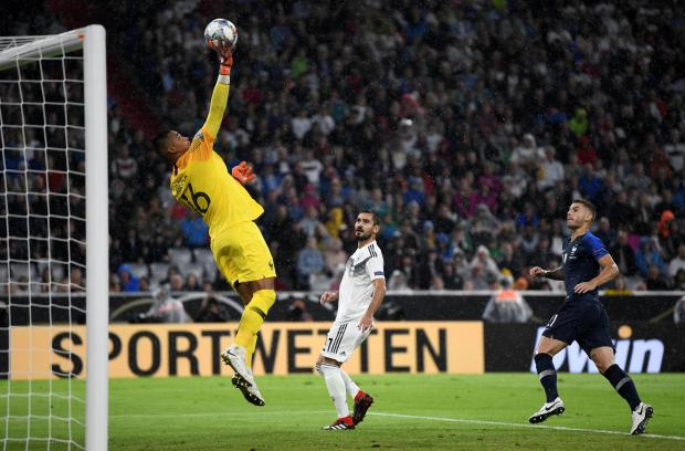 France's Alphonse Areola and Lucas Hernandez in action with Germany's Ilkay Gundogan.