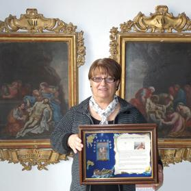Carmen Axiaq with her ex-voto painting.