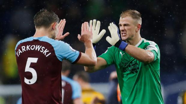 Burnley's Joe Hart (right) celebrates with James Tarkowski after the match