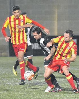 Senglea player-coach Pablo Doffo (right) challenges Hibs winger Renan Telles. Photo: MarkZammit Cordina