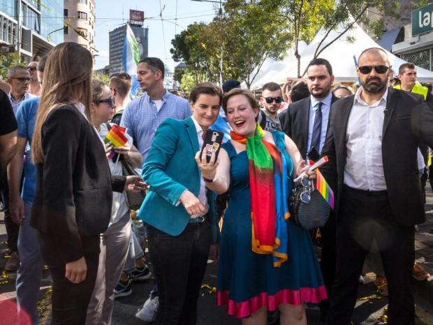 Prime Minister Ana Brnabic (left) taking a selfie with a fan during 2018 edition of Belgrade Gay Pride. Photo: Shutterstock