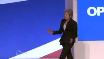 Theresa May dances onto stage for Conservative conference speech