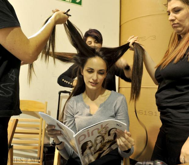 A model reads the latest edition of Pink magazine while her hair is being done at the Pink fashion show which was held at Progress Press on November 13. Photo: Chris Sant Fournier