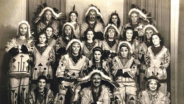 Red Indians, 1949. Front row, seated (from left): (1) Mafine Xuereb (Mrs Leslie Grech), (2) Tony Debono, (3) Mollie Debono (Mrs Freddie Zammit Tabona). Second row, seated: (2) Mary de Giorgio (Mrs Maurice de Giorgio), (3) Jojo Gatt. Third row, standing: (1) Maurice Bonello, (2) Madeleine Debono (Mrs Ronnie Trigona), (3) Barbara Bonavia, (4) Charlie Sammut, (5) Josephine Azzopardi (Mrs Charlie Sammut), (7) Barbara Salamone (Mrs Robert Bonavia), (8) Ronnie Trigona, (9) Elizabeth Debono (Mrs Hadrian Vincenti). Back row, standing: (1) Leslie Grech, (5) Sonny Muscat. Photo: Grech's Studio, Valletta
