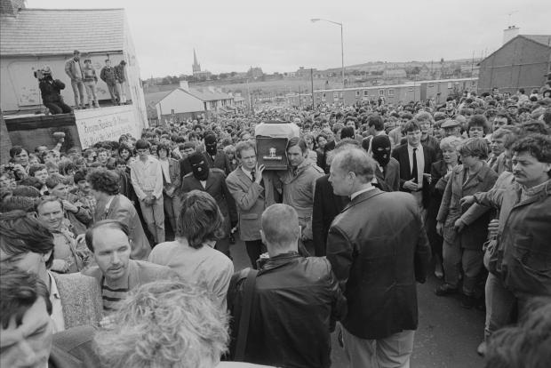 File photo dated August 1985 of Noraid leader Martin Galvin (right) standing alongside Martin McGuinness, as the two men acted as pall-bearers at the Londonderry funeral of IRA man Charles English.
