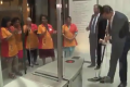 Dutch prime minister takes mop to clear up his spilled coffee