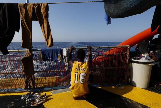 A migrant looks out to sea from the stern of the Medecins san Frontiere (MSF) rescue ship Bourbon Argos somewhere between Libya and Sicily on August 8. The 241 mostly West African migrants on the ship were taken to Trapani in Sicily. Photo: Darrin Zammit Lupi