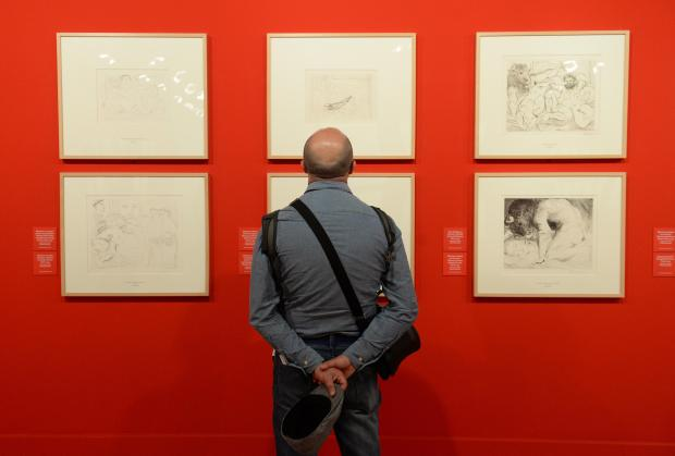 A man enjoys an exhibition of Pablo Picasso and Joan Miró artworks -two Spanish giants of 20th-century art at the Grand Master's Palace in Valletta on April 24. Photo: Matthew Mirabelli