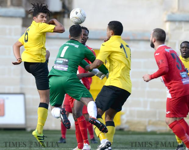 Qormi's Yannick Yankam (left), tries to head the ball past Mqabba keeper Jonathan Debono during their BOV First Division match at the Victor Tedesco Stadium in Hamrun on February 11. Photo: Matthew Mirabelli