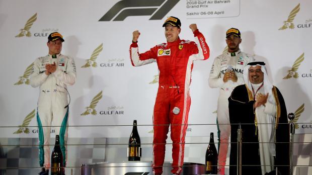 Ferrari's Sebastian Vettel, Mercedes' Lewis Hamilton and Mercedes' Valtteri Bottas celebrate on the podium after the race.