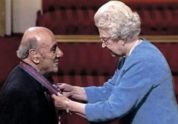 Prof. Gilles receiving the insignia of Companion of the Order of St Michael and St George from Queen Elizabeth II, 2005.