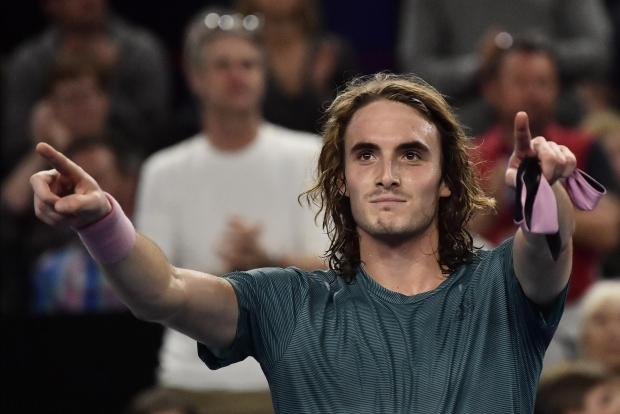 Greece's Stefanos Tsitsipas celebrates after winning against Kazakhstan's Mikhail Kukushkin in their men's singles final match at the ATP Open.
