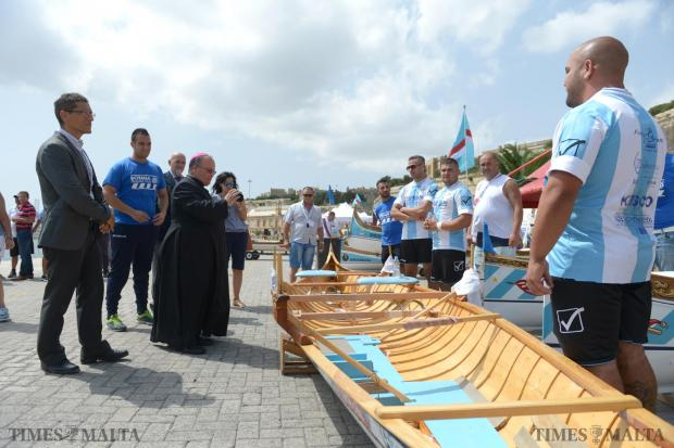 Archbishop Charles Scicluna blesses one of the boats taking part in the Victory Day Regatta in Valletta on September 8. Photo: Matthew Mirabelli