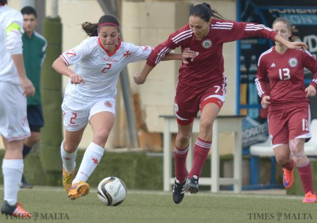 Malta's Gabriella Zahra (left) fends off Latvia's Glina Ozola during soccer friendly at the Centenary Stadium in Ta'Qali on January 19. The Maltese women's national team won the match 3-0. Photo: Matthew Mirabelli
