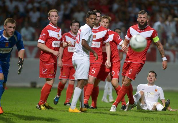 Valletta and Newton players look on as the ball is deflected after a corner during their Europa League match at Hibs Stadium in Paola on July 9. Photo: Matthew Mirabelli