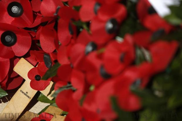 Remembrance crosses and poppy wreaths are seen on the war memorial cenotaph after the Remembrance Sunday ceremony in Floriana on November 13. Photo: Darrin Zammit Lupi