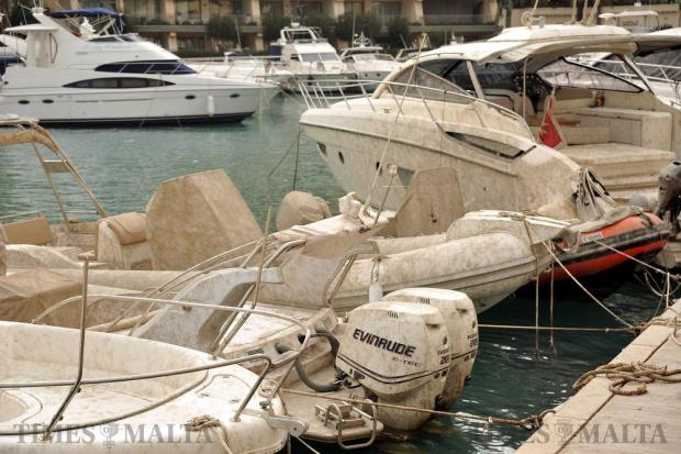 Boats covered in mud and slime are seen at the Portomaso marina in the aftermath of the storm on October 30. Photo: Chris Sant Fournier