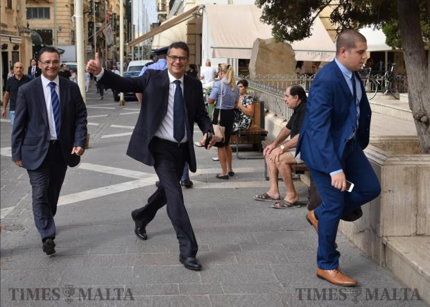 Newly appointed Nationalist party leader Adrian Delia gives the thumbs up to people waiting outside the courts in Valletta on September 19. Photo: Mark Zammit Cordina