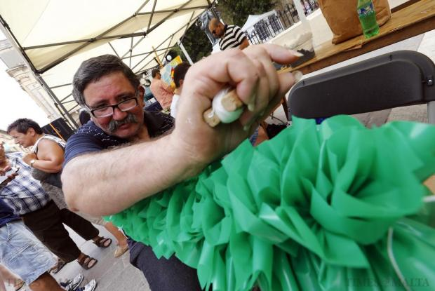 A participant makes traditional Maltese feast decorations (liedna) during the Intercultural Music and Arts Festival in Valletta on June 6. The festival is part of the Intercultural City Strategy for Valletta 2015-2018, which promotes integration, inclusion, intercultural exchange and diversity. Photo: Darrin Zammit Lupi