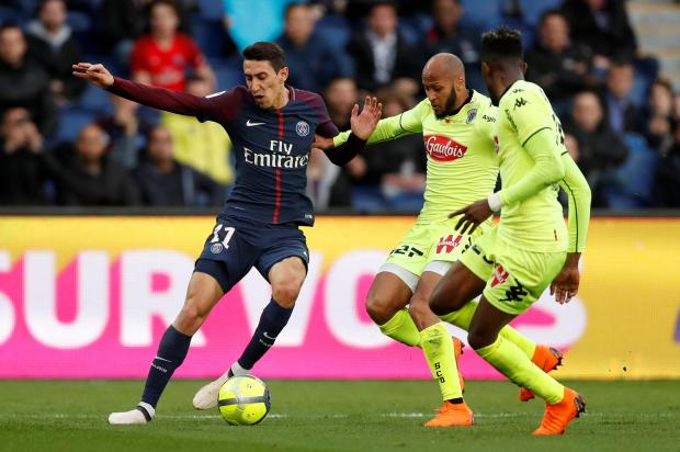 Paris Saint-Germain's Angel Di Maria in action with Angers' Thomas Toure.