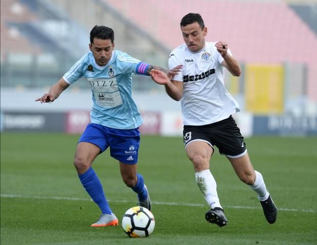 John Mintoff (left) of Sliema Wanderers tussles for the ball with Hibernians' Clayton Failla. Photo: Matthew Mirabelli