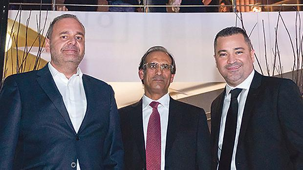 Economy Minister Chris Cardona, Majid Al Sadi and Dino Fino.