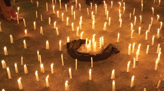 Lit candles are placed on the ground in old Damascus, yesterday, during a protest against the Israeli attacks on Gaza.