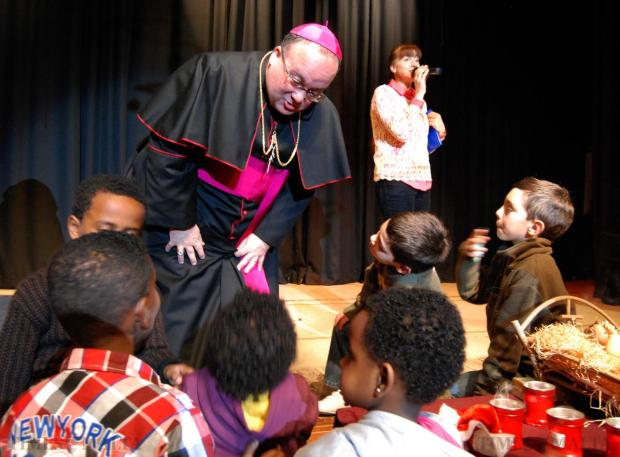 Apostolic Administrator Charles Scicluna attends a children's party in Rabat on December 21. Photo: Mark Zammit Cordina