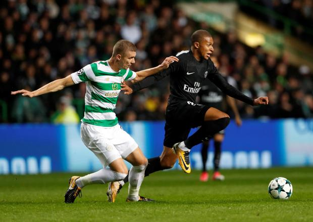 Kylian Mbappe (right) was on the mark as PSG thumped Celtic 5-0.