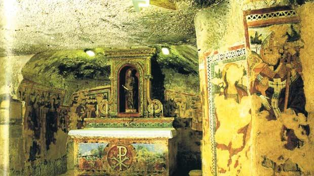 The medieval chapel with altar and frescoes at St Agatha's Catacombs.